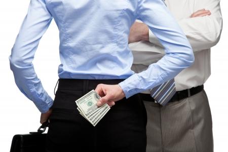 Woman hiding money and man in the background - closeup shot Foto de archivo