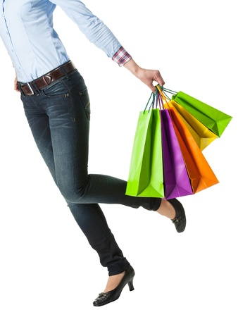 Attractive girl holding multicolored shopping paper bags - closeup shot on white background Stock Photo - 17850862
