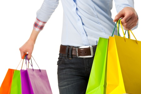 Woman holding multicolored shopping paper bags - closeup shot on white background Stock Photo - 17959187