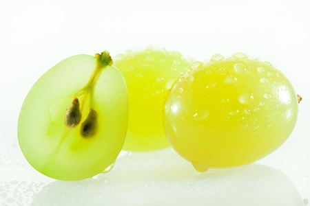 Juicy green grapes - macro shot of cut berries on white background 스톡 콘텐츠