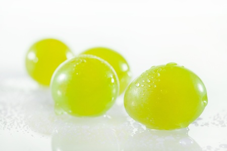 Juicy green grapes - macro shot of whole berries on white background Stock Photo - 17959034