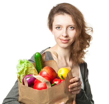 Beautiful young woman with vegetables and fruits in shopping bag; isolated on white Stock Photo - 17850868