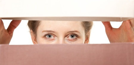 closeup of young woman's eyes watching you closely photo