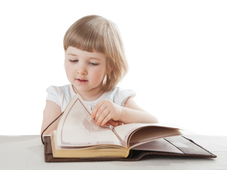 Pretty little girl reading an interesting book; white background photo