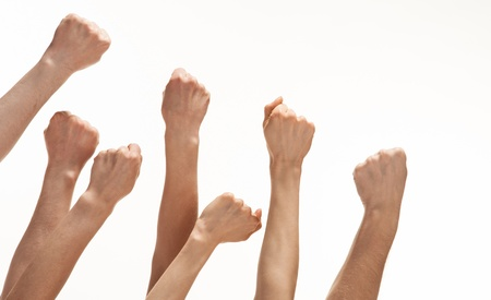 Group of hands showing fists raised up, white background, copy space