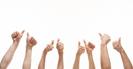 Many hands showing thumb up signs on white background Stock Photo
