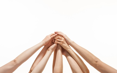 Successful team  many hands holding together on white background