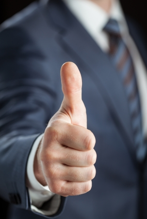 Businessman showing thumbs up - closeup shot Stock Photo - 18157861