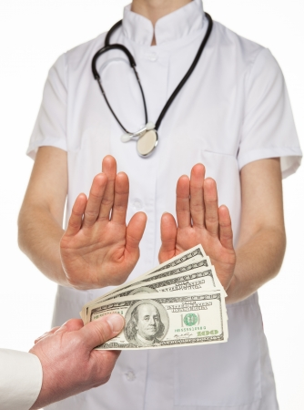 Doctor decidedly refuses to take money from patient, white background Stock Photo - 18157822