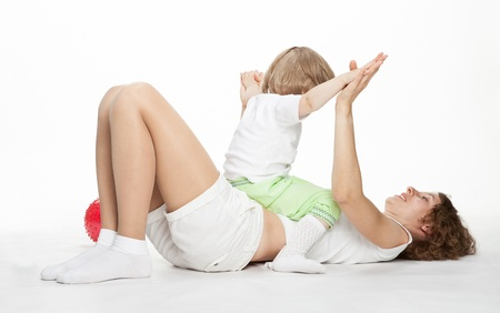 limbering: Happy mother doing sport exercises with little daughter