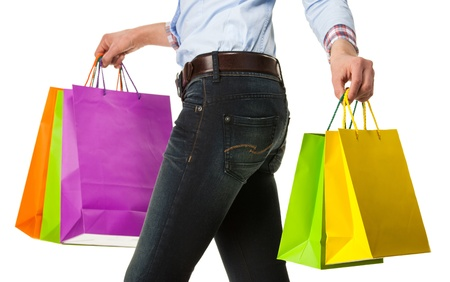 Woman holding multicolored shopping paper bags - closeup shot on white background Stock Photo - 19310216