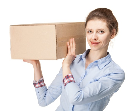 Smiling young woman carrying a big box; isolated on white background photo