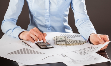 Business accountant working with documents and money photo
