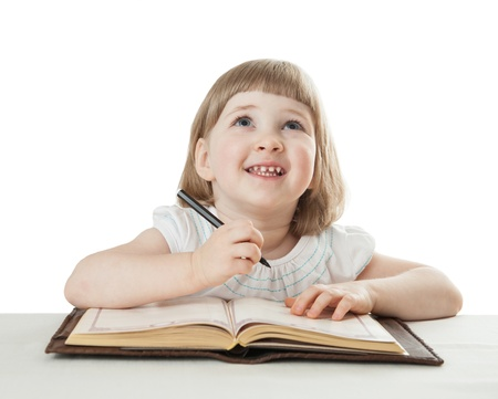 Smiling little girl holding a pen and looking up photo