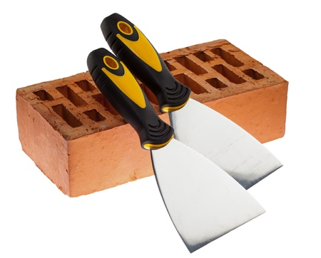 putty knives: Plastering putty knives and a brick isolated over white background