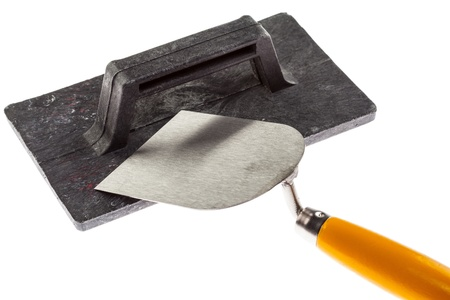 plastering: Plastering trowel and construction surfacer isolated over white background Stock Photo