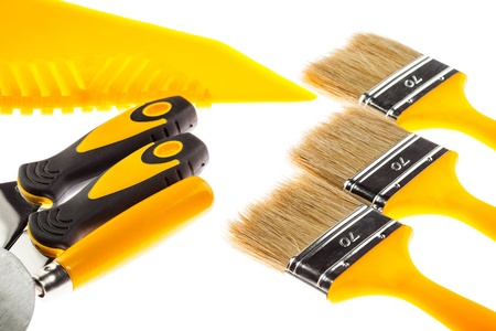 Plastering and painting construction tools isolated over white background photo