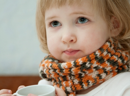 convalesce: Little girl with a cup of tea