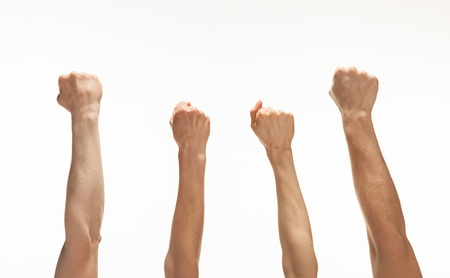 Four hands showing fists raised up, white background Stock Photo