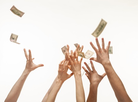 money falling: Many hands competing for catching money falling from above, white background