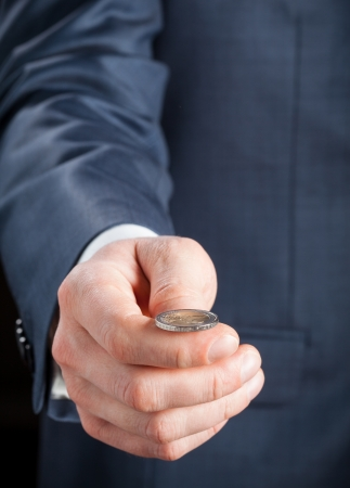 coin toss: Businessman tossing a coin Stock Photo