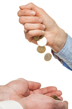 Pouring coins into hands on white backhround photo