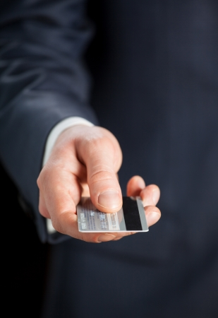 credit card payment: Businessman giving credit card to you