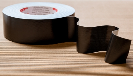 dielectric: Black isolating (dielectric) tape on neutral background
