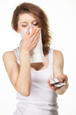 Woman having allergy and selects drug; white background Stock Photo - 20903971