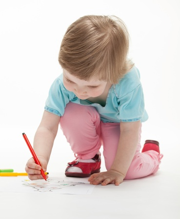 child drawing: Child drawing a picture with colorful felt-tip pens; white background Stock Photo