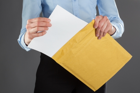 Businesswoman taking letter out of envelope, closeup shot Stock Photo - 20934997