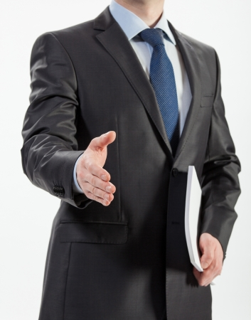 proposition: Businessman offering handshake to you isolated on white Stock Photo
