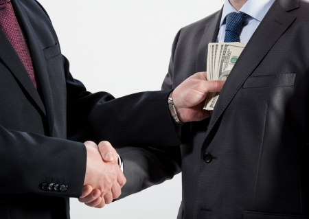 Giving a bribe into a pocket - closeup shot Stock Photo