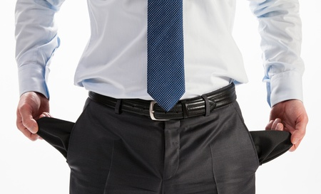 Businessman showing his empty pockets - closeup shot photo