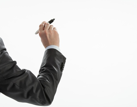 alzando la mano: Hombre de negocios de la mano que escribe algo en una pared blanca