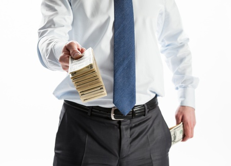 Businessman offering money to you on white background