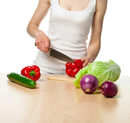 Young woman preparing salad isolated on white; healthy eating concept