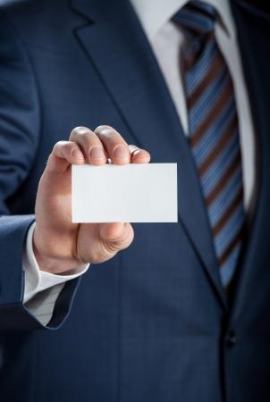 Mans hand showing business card - closeup shot