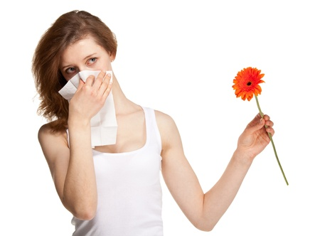 Woman having allergy from spring flowers isolated on white background Stock Photo - 21318930