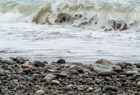 storming: Storming sea and pebbly shore Stock Photo