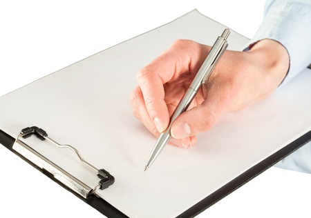 Woman's hands holding blank sheet of paper in a clipboard and a pen; isolated on white photo