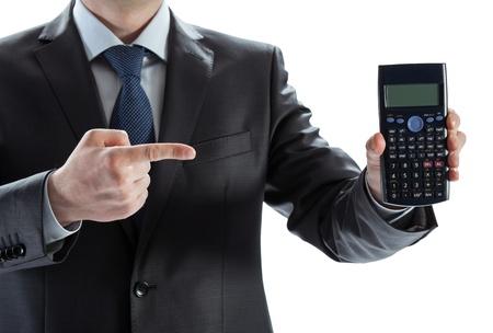 Closeup of a businessman showing calculator photo