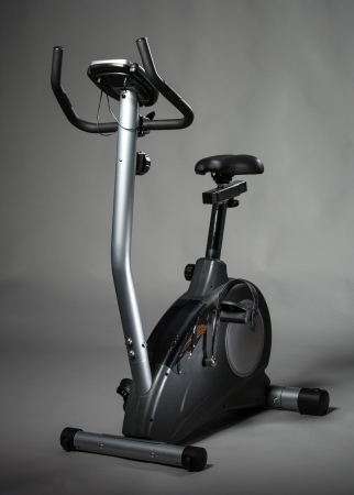 hometrainer: Stationary training bicycle on grey background, studio shot Stock Photo