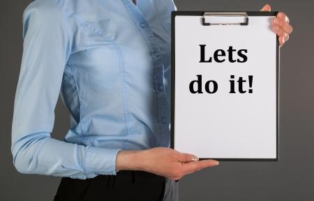 lets: Businesswoman holding blank clipboard - closeup shot