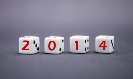 brink: Four dice with 2014 inscription on dark background
