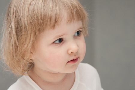ruffle: Portrait of a baby girl at home Stock Photo