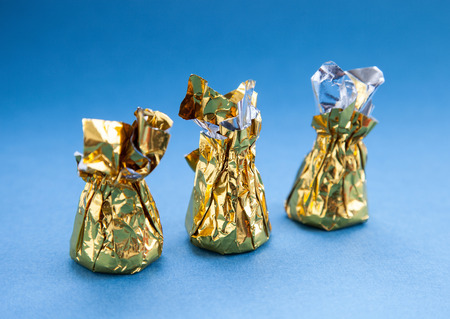 sweetmeats: Sweetmeats in a gold foil on a blue background
