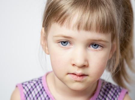 sad cute baby: Portrait of a beautiful little girl - closeup shot