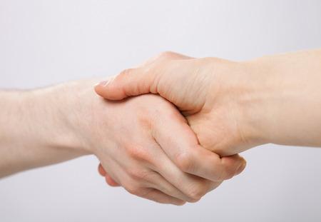 Handshake on grey background photo