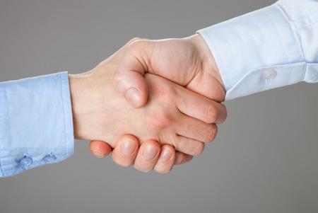 Business handshake on gray background photo